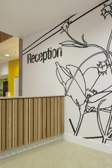 Projects Health Athletes Village reception graphics Penoyre and Prasad