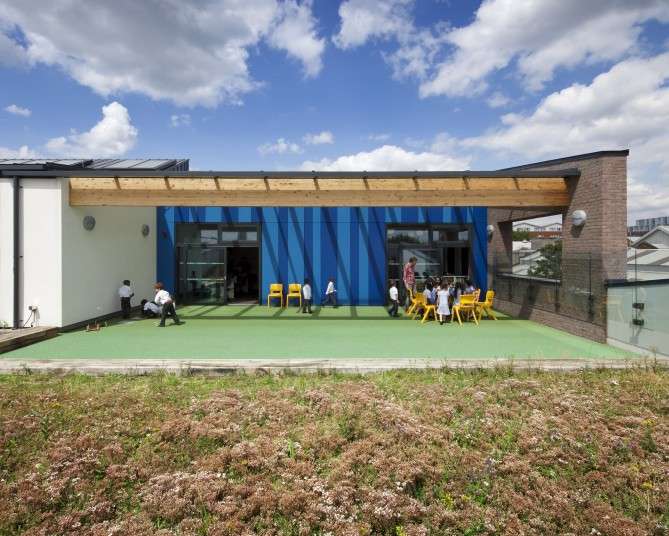 Ark Brunel Primary School external teaching terrace with green roof Penoyre & Prasad Architects